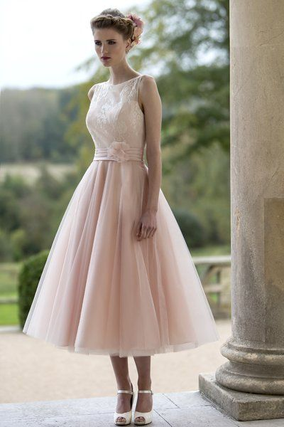 Tea-length-wedding-dress-with-delicate-lace-bodice-and-sheer-neckline-and-full-Tulle-Fifties-style-skirt