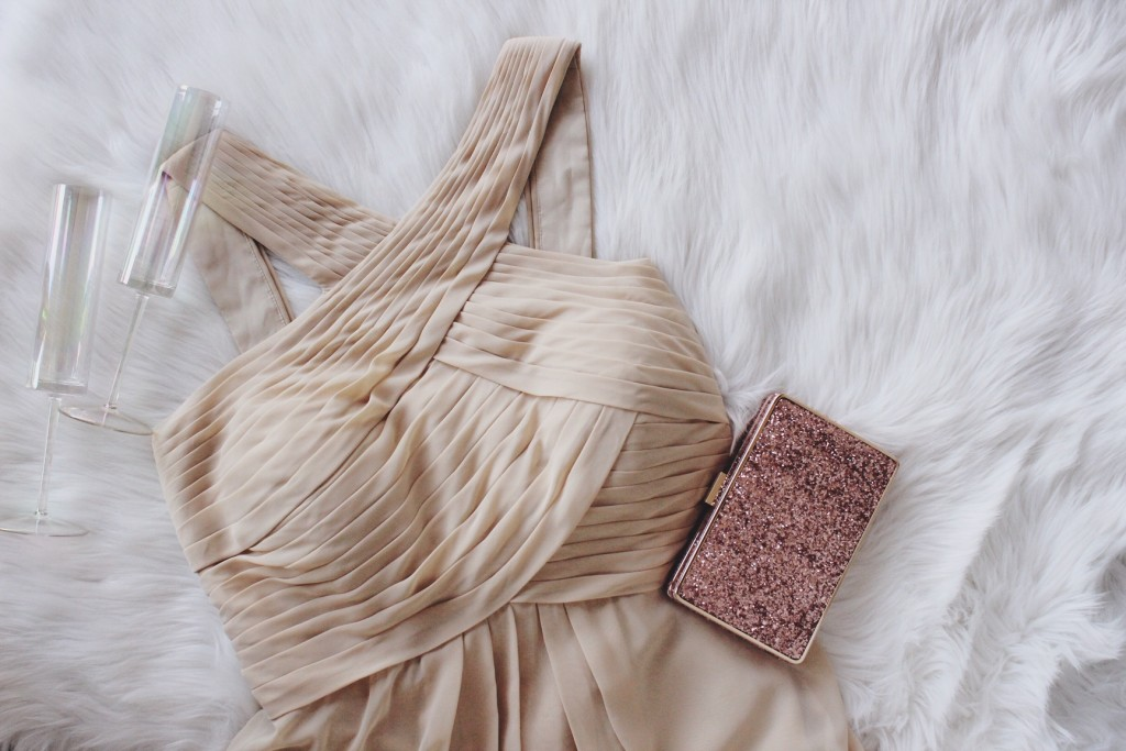 Azazie Kailyn bridesmaid dress in champagne with sequin clutch.